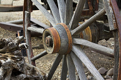 Poster featuring the photograph Old Waagon Wheel by Phyllis Denton