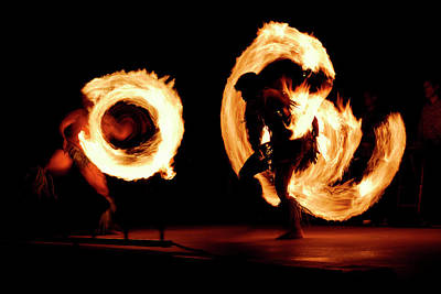 Pair Of Competing Fire Dancers Spinning Lit Batons At Night Afte Poster by Reimar Gaertner