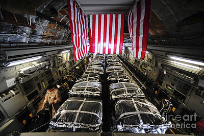Pallets Of Cargo Inside Of A C-17 Poster by Stocktrek Images