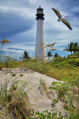 Pelican Flying Over Cape Florida Lighthouse Poster