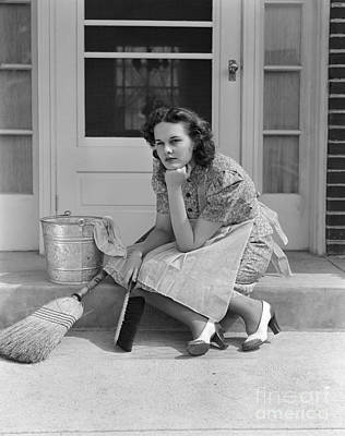 Pensive Woman With Cleaning Tools Poster by H. Armstrong Roberts/ClassicStock