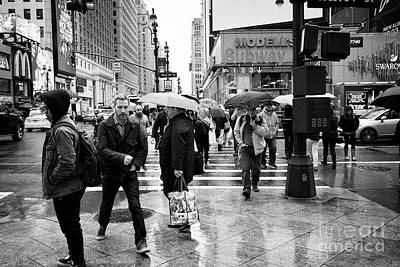 people crossing crosswalk in busy street in the rain New York City USA Poster
