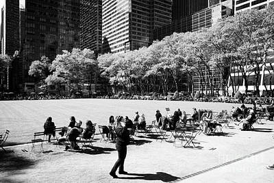 People Eating Lunch Sitting In The Chairs In Bryant Park New York City Usa Poster