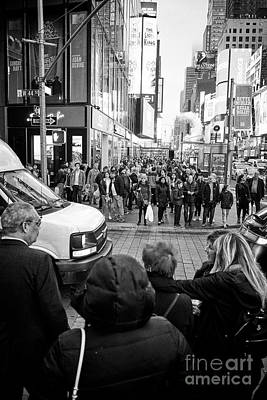 people waiting at crosswalk with full busy sidewalk in the evening evening in Times Square New York  Poster