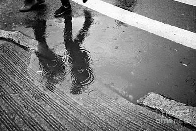 people walking past rainwater starting to flood on streets New York City USA Poster