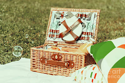 Picnic Basket Food On White Blanket With Pillows And Soap Bubbles Poster by Radu Bercan