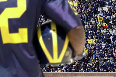 Player Cradling Helmet In Stadium Poster