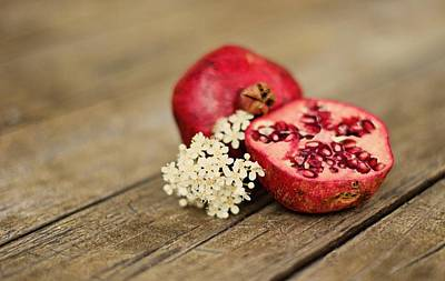 Pomegranate And Flowers On Tabletop Poster by Anna Hwatz Photography Find Me On Facebook