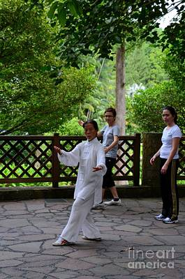 Practising Early Morning Tai Chi Exercise In Singapore Park Poster by Imran Ahmed