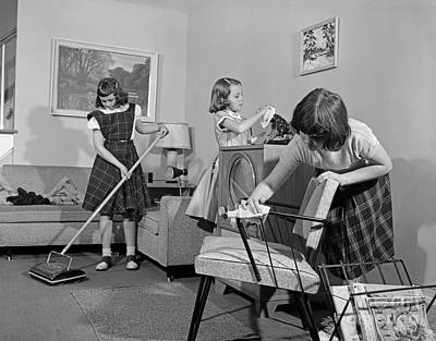 Preteen Girls Cleaning Living Room Poster by H. Armstrong Roberts/ClassicStock