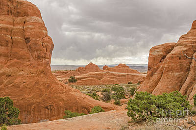 Poster featuring the photograph Rain In The Distance At Arches by Sue Smith