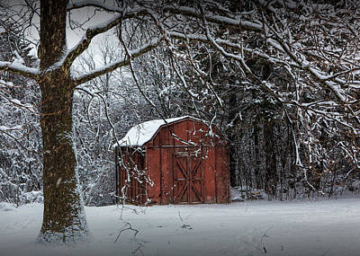 Red Utility Barn Among The Trees During A Snowstorm Poster by Randall Nyhof