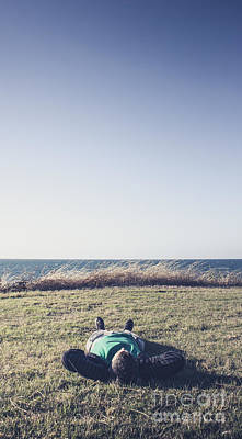 Resting Young Man Lying Down On A Grass Field Poster by Jorgo Photography - Wall Art Gallery