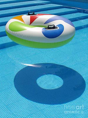 Ring In A Swimming Pool Poster by Michael Canning