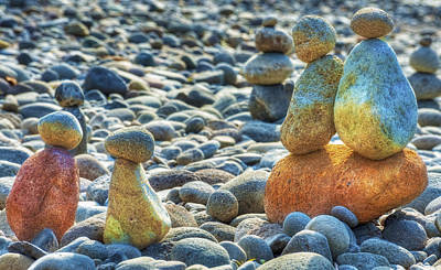 Stacked Rocks On A Rocky Beach Poster