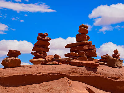 Rock Cairns In The Desert Poster