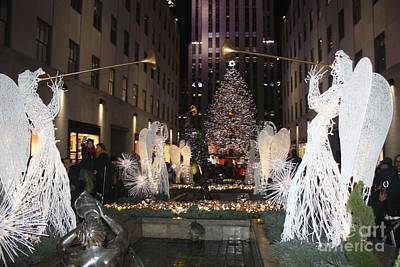 Rockefeller Center Snow Angels And Christmas Tree At Night Poster by John Telfer