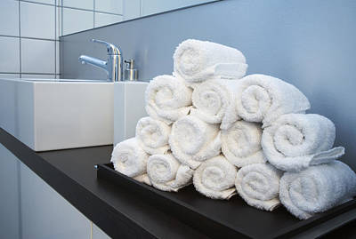 Rolled Towels Stacked In The Shape Of A Pyramid Poster