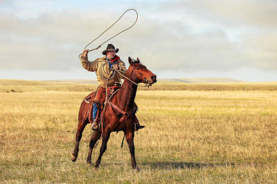 Roping On The High Plains Poster by Todd Klassy