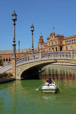 Row Boating In Seville Poster by Carlos Caetano