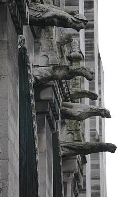 Poster featuring the photograph Row Of Gargoyles by Christopher Kirby