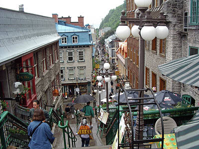 Poster featuring the photograph rue du Petit Champlain by John Schneider