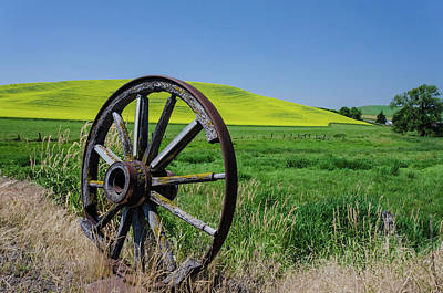 Rustic Wagon Wheel In The Palouse Poster by James Hammond