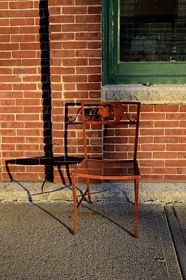 Poster featuring the photograph Rusty Chair At Sunset by Corinne Rhode
