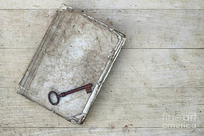 Poster featuring the photograph Rusty Key On The Old Tattered Book by Michal Boubin
