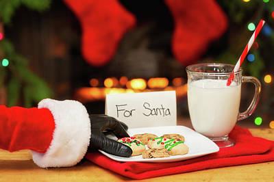 Santa Grabbing Christmas Cookies Poster