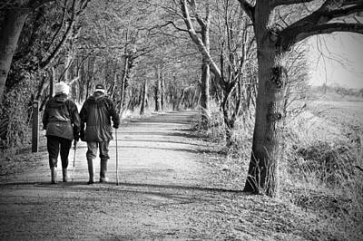 Senior Couple Walking Through The Woods Poster by Fizzy Image