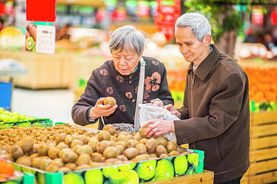 Senior Man And Woman Shopping Fruit Poster