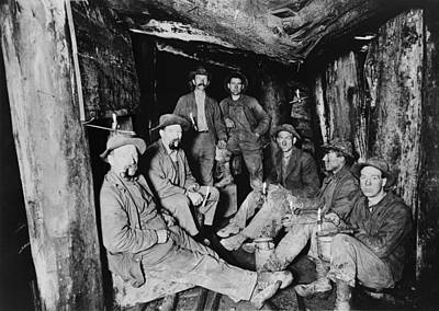 Seven Miners Pose For A Photograph Poster by Everett