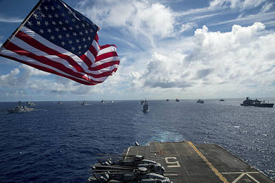 Ships Gather In Formation Aft Of The Amphibious Assault Ship Uss Peleliu  Poster by Celestial Images