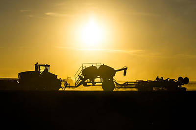 Sillhouette Of Tractors Planting Wheat Poster