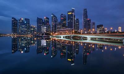 Poster featuring the photograph Singapore Skyline Reflection by Pradeep Raja Prints