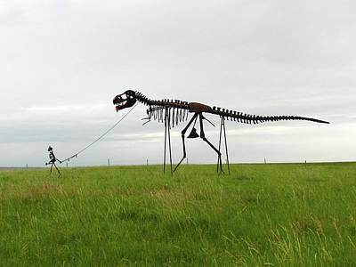 Skeletal Man Walking His Dinosaur Statue Poster