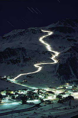 Skiers Bearing Torches Ski Down Mont Poster
