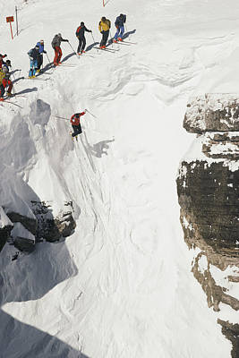Skilled Skiers Plunge More Than 15 Feet Poster