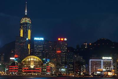 Skyline Illuminated At Night From Kowloon Poster