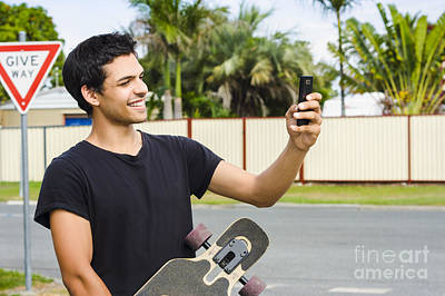 Smiling Skateboarder Man Taking Cell Phone Photo Poster by Jorgo Photography - Wall Art Gallery