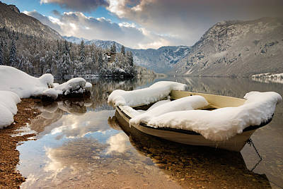 Snow Covered Boat On Lake Bohinj In Winter Poster