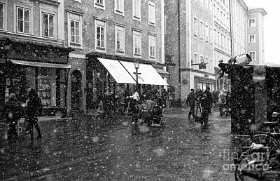 Snowflakes In Salzburg Poster by John Rizzuto