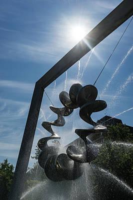 Spiral Sculpture Fountain With A Sun Burst Poster by Georgia Mizuleva