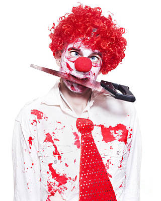 Spooky Clown Holding Bloody Saw In Mouth On White Poster by Jorgo Photography - Wall Art Gallery