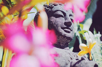 Stone Carved Statue Of Buddha Surrounded With Colorful Flowers Bali, Indonesia Poster
