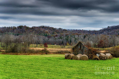 Storm Clouds And Hay Bales Poster
