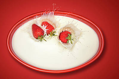 Strawberries Splashing In Milk Poster