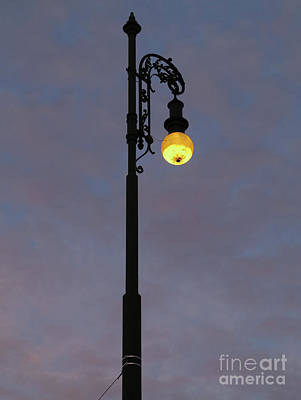 Poster featuring the photograph Street Lamp Shining At Dusk by Michal Boubin