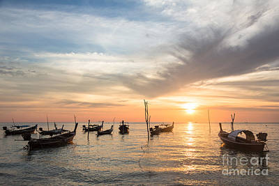 Stunning Sunset Over Wooden Boats In Koh Lanta In Thailand Poster